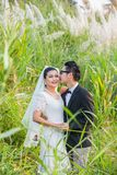 Asian couple groom and bride. With outdoor prewedding portrait in nature background Stock Photo