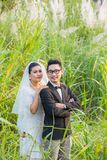 Asian couple groom and bride. With outdoor prewedding portrait in nature background Royalty Free Stock Photo