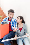 Asian couple with ground plot planning arrangement of new apartm Royalty Free Stock Photos