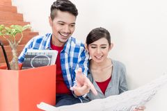 Asian couple with ground plot planning arrangement of new apartm stock photos