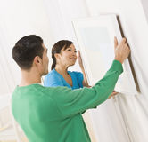Asian couple hanging art Stock Photo