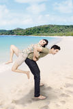 Asian couple have fun at beach Stock Photo