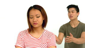 Asian couple having argument. On white screen stock video footage