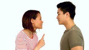 Asian couple having argument. On white screen stock video
