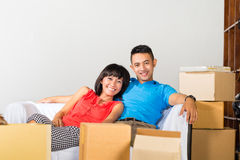 Asian couple having break while moving in royalty free stock photos