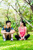 Asian couple having break at during sport training Stock Images
