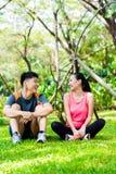 Asian couple having break at during sport training Stock Images