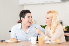 Asian couple having breakfast together Stock Images