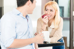 Asian couple having breakfast together Royalty Free Stock Images