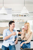 Asian couple having breakfast together Royalty Free Stock Photography