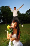 Asian Couple Having fun In The Park Stock Images