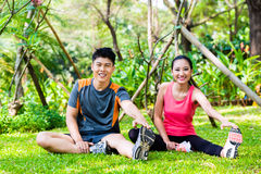 Asian couple having outdoor fitness sport training Stock Photos