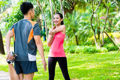 Asian couple having outdoor fitness sport training stock images