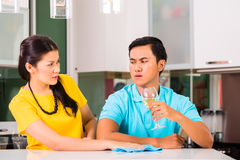 Asian couple having relationship difficulties. Young Asian handsome couple having relationship difficulties with alcohol problems and domestic violence stock image