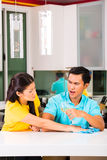 Asian couple having relationship difficulties. Young Asian handsome couple having relationship difficulties with alcohol problems and domestic violence Stock Photography