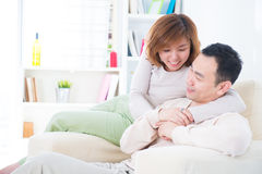 Asian couple having sweet talk. At home Royalty Free Stock Photography