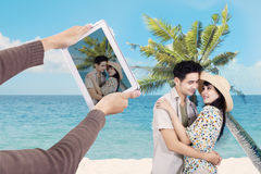 Asian couple at Hawaii beach Royalty Free Stock Photo