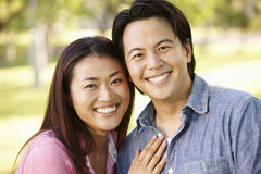 Asian couple head and shoulders portrait outdoors Royalty Free Stock Image