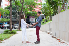 Asian couple hold hands happy smile looking to Royalty Free Stock Photos