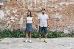 Asian couple holding hands together Stock Photos