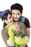 Asian couple holding a plant - isolated Royalty Free Stock Images