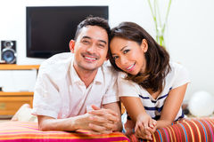 Asian couple at home in their living room Stock Photos