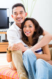 Asian couple at home in their living room Royalty Free Stock Photos