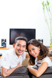 Asian couple at home in their living room Stock Photography