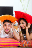 Asian couple at home in their living room Stock Images