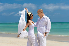 Asian couple honeymoon at the beach Stock Photos