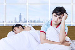 Asian couple insomnia at bedroom apartment Stock Photo