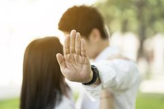 Asian couple kissing outdoor in the park. Close up Stock Image