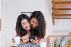Asian couple lesbian hug each other when have breakfast in morning at home.LGBTQ lifestyle concept.  royalty free stock photography