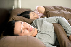 Asian couple lifestyle sleeping Stock Images