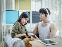Asian Couple Listening To Music Royalty Free Stock Images