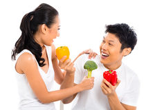 Asian couple living healthy. Asian couple eating and living healthy Stock Photo