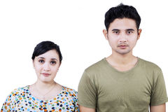 Asian couple looking at camera - isolated Stock Image