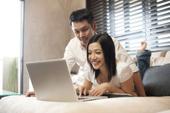 Asian Couple  looking at the computer screen Stock Photos