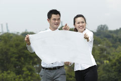 Asian couple looking at plans. Stock Photography