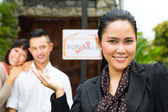 Asian couple looking for real estate Royalty Free Stock Photo
