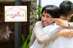 Asian couple looking for real estate Royalty Free Stock Image