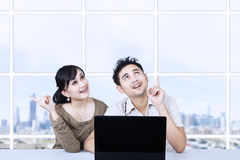 Asian couple looking up in office Royalty Free Stock Photo