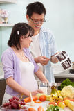 Asian couple looking at USG fetus picture Royalty Free Stock Image