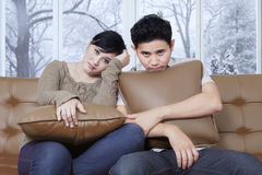 Asian couple looks bored at home Royalty Free Stock Photography