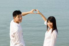 Asian couple making heart symbol Royalty Free Stock Photography