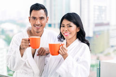 Asian couple in morning front of city skyline Royalty Free Stock Image