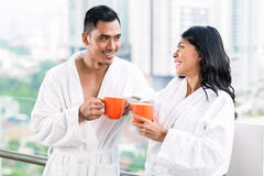 Asian couple in morning front of city skyline Royalty Free Stock Photos