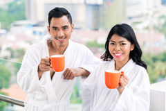 Asian couple in morning front of city skyline stock photography