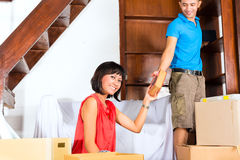Asian couple moving in the new home Royalty Free Stock Photo