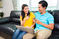 Asian couple online shopping with credit card Stock Image
